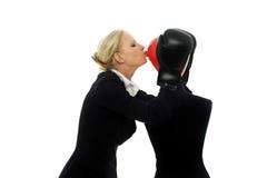 Donna di affari che bacia un manichino Immagini Stock Libere da Diritti