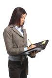 Donna di affari che cattura le note Fotografia Stock Libera da Diritti