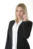 Donna di affari che comunica sul telefono delle cellule fotografia stock