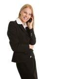 Donna di affari che comunica sul telefono mobile Fotografia Stock