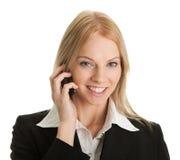 Donna di affari che comunica sul telefono mobile Fotografie Stock Libere da Diritti