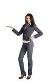 Donna di affari che esamina il vostro prodotto Fotografia Stock