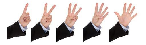 Donna di affari che fa i numeri con la mano Immagini Stock Libere da Diritti