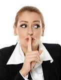 Donna di affari che fa il segno di silenzio Immagini Stock Libere da Diritti