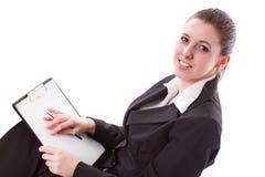 Donna di affari che fa presentazione sul bordo Immagine Stock
