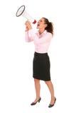Donna di affari che grida tramite il megafono Immagini Stock