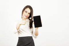 Donna di affari che indica alla compressa fotografia stock libera da diritti