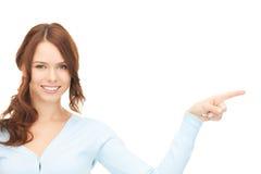 Donna di affari che indica la sua barretta Fotografia Stock Libera da Diritti