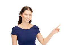 Donna di affari che indica la sua barretta Fotografia Stock