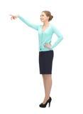Donna di affari che indica la sua barretta Immagine Stock
