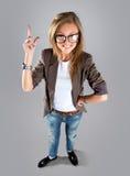 Donna di affari che indica mostra e che guarda al lato su Fotografia Stock Libera da Diritti