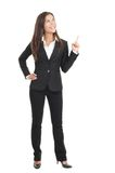Donna di affari che indica sulla priorità bassa bianca Fotografia Stock