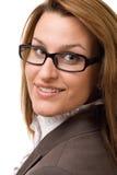 Donna di affari che lo esamina Fotografia Stock