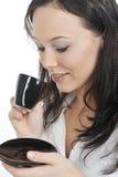 Donna di affari che mangia caffè Fotografie Stock Libere da Diritti
