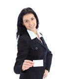 Donna di affari che mostra e che passa uno spazio in bianco immagine stock
