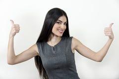 Donna di affari che mostra i pollici su Immagine Stock