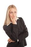 Donna di affari che osserva seriamente fotografia stock