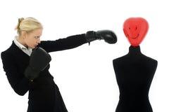 Donna di affari che perfora un manichino Fotografia Stock Libera da Diritti