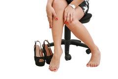 Donna di affari che porta i pattini degli alti talloni Immagine Stock