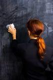 Donna di affari che pulisce la sua ardesia pulita Fotografia Stock