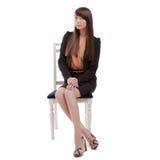 Donna di affari che si siede nella sedia Fotografia Stock Libera da Diritti