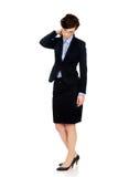 Donna di affari che soffre dal dolore al collo Immagini Stock
