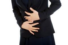Donna di affari che soffre dal mal di stomaco Fotografia Stock Libera da Diritti