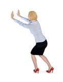 Donna di affari che spinge qualcosa Fotografia Stock Libera da Diritti