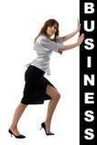 Donna di affari che spinge qualcosa Immagine Stock