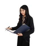 Donna di affari che sta lavorando Fotografia Stock