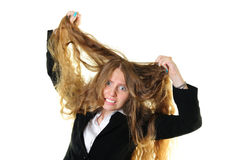Donna di affari che strappa i suoi capelli Fotografie Stock