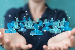 Donna di affari che tiene e che tocca 3D che rende gruppo di pe blu Immagine Stock Libera da Diritti