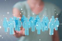 Donna di affari che tiene e che tocca 3D che rende gruppo di pe blu Immagini Stock