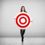 Donna di affari che tiene grande obiettivo Fotografia Stock Libera da Diritti