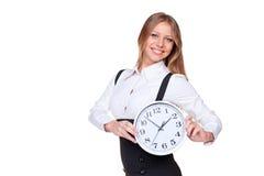 Donna di affari che tiene l'orologio Fotografia Stock