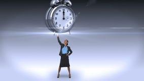Donna di affari che tiene sveglia gigante video d archivio