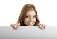 Donna di affari che tiene un tabellone per le affissioni immagini stock