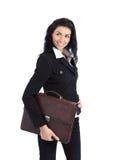 Donna di affari che tiene una condizione della cartella immagini stock