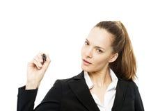 donna di affari che tiene una penna di marcatura Immagini Stock