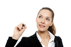 Donna di affari che tiene una penna di marcatura Fotografie Stock Libere da Diritti