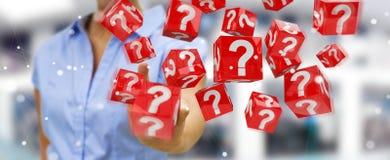 Donna di affari che usando i cubi con i punti interrogativi della rappresentazione 3D Fotografie Stock