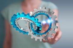 Donna di affari che usando la rappresentazione moderna di galleggiamento del meccanismo di ingranaggio 3D Fotografia Stock Libera da Diritti