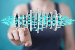 Donna di affari che usando la rappresentazione moderna di galleggiamento del meccanismo di ingranaggio 3D Fotografia Stock