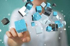 Donna di affari che usando renderin brillante blu di galleggiamento della rete 3D del cubo Fotografia Stock