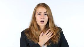 Donna di affari colpita che ritiene il problema, fondo bianco Fotografia Stock