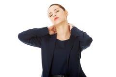 Donna di affari con dolore alla schiena Immagine Stock