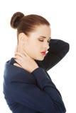 Donna di affari con dolore alla schiena Immagini Stock