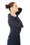 Donna di affari con dolore alla schiena Immagini Stock Libere da Diritti