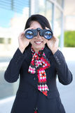 Donna di affari con il binocolo Fotografia Stock Libera da Diritti