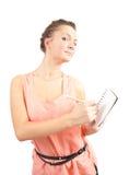 Donna di affari con il blocchetto per appunti e la matita Fotografia Stock